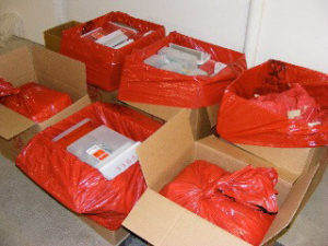Biomedical waste in boxes for disposal.